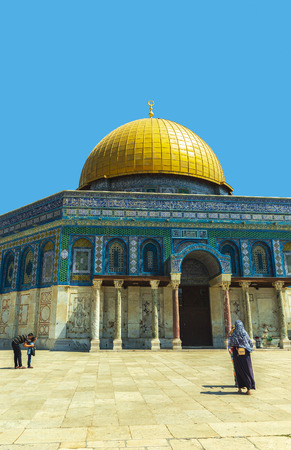 Unrecognisable veiled muslim woman and father showing child the dome of the rock