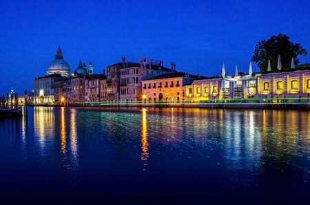 View of Grand Canal and Basilica della Salute at night with boat night trails Banco de Imagens