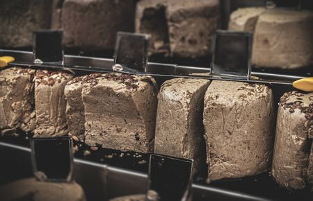 A series of typical Jewish Halva cakes with different flavours  Banco de Imagens