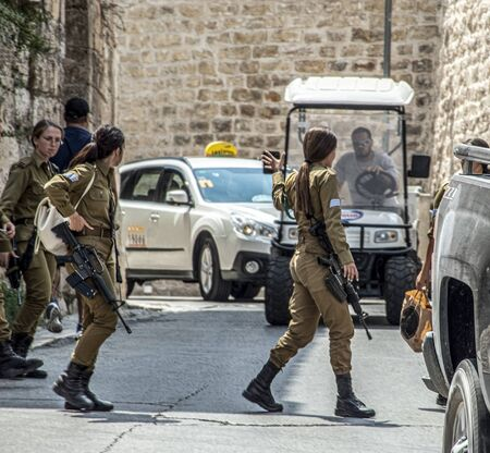 Young female soldiers of the Israeli Army checking the roads in Jerusalem