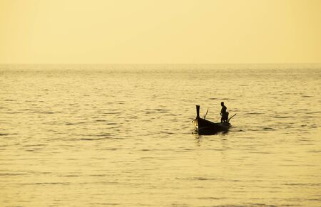 Asian fisherman returning in the evening Banco de Imagens