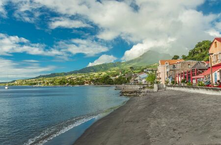 View of Saint-Pierre on Martinique island and Mount Pelee volcano Stock Photo