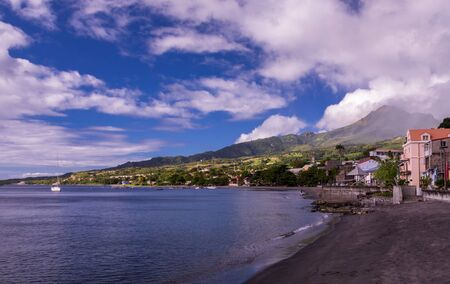 View of Saint-Pierre on Martinique island and Mount Pelee volcano at sunset