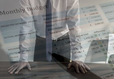 Business man hands on table with balance sheet Archivio Fotografico - 139504127