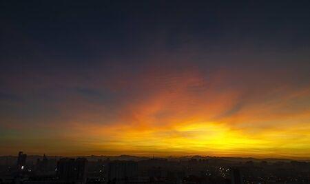 Skyline of Kuala Lumpur awakening in astounding sunset