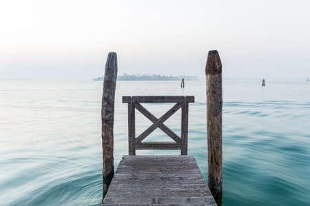 Cold winter calm on pier over Venice lagoon