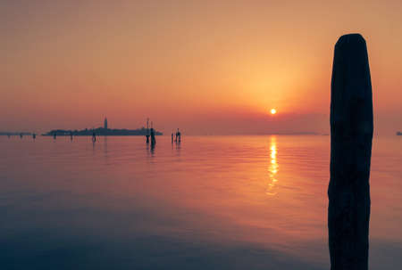 Colourful red and purple sunset over Venice lagoon