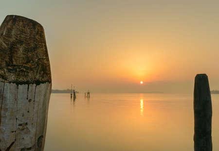Colourful yellow sunset over Venice lagoon
