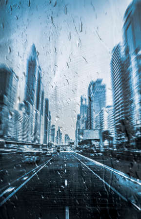 Dubai city centre in the rain from the middle of the road in speed