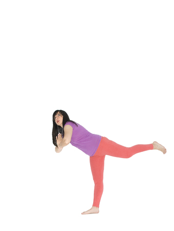 loosen up: Barefoot women loosen up with yoga exercise and listening to music -  isolated white - copy space