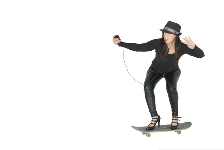 women wearing high heels on skateboard taking selfie and  listening to music -  isolated white - copy space