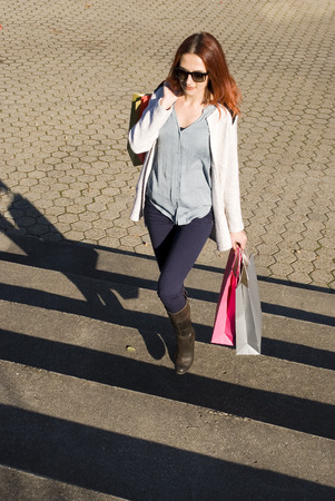 paperbag: Young cheerful woman holding shopping bags