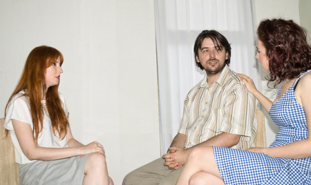 the topics: Marriage Therapy. Couple Talking to Counselor Stock Photo
