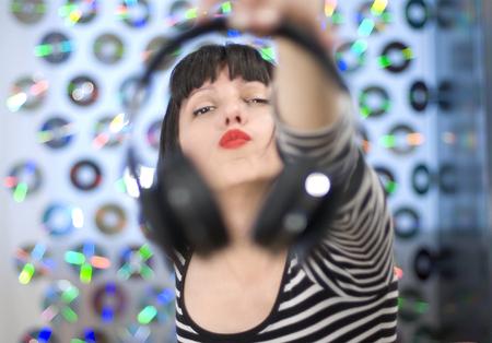 Attractive woman sharing music Stock Photo