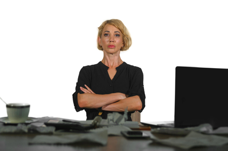 lifestyle isolated portrait of young serious and upset business woman working at office laptop computer desk feeling sad and depressed looking unhappy and angry in job stress and mess Фото со стока