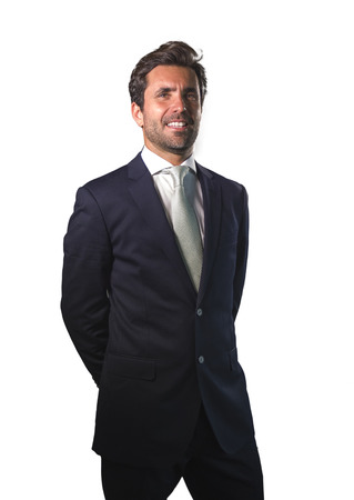 young elegant and handsome happy man in suit posing for company corporate business portrait relaxed and confident smiling happy isolated on white as successful ceo executive businessman