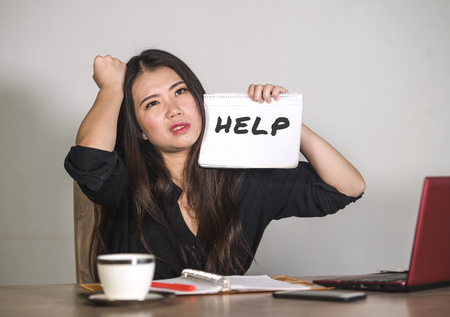 young stressed and depressed Asian Chinese businesswoman working overwhelmed and exhausted as corporate business employee asking for help desperate and frustrated in job problem