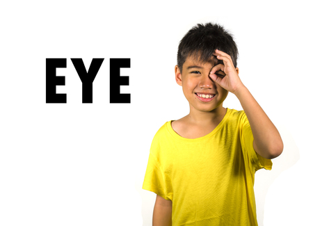 English language learning card with portrait of 8 years old child pointing his eye isolated on white background as part of school cards set of body and face parts in education and idiom lesson