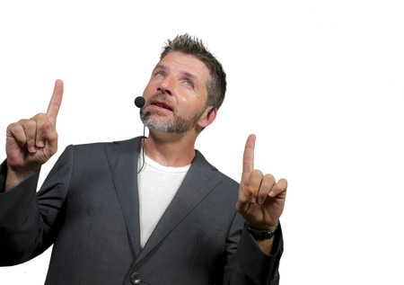 young attractive and confident successful man with headset speaking at corporate business coaching and training auditorium conference room talking giving motivation training isolated on white
