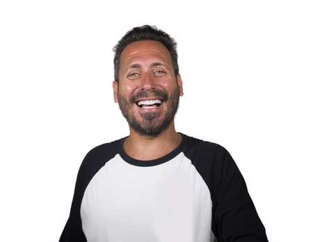 portrait of young happy and positive attractive 40s man with blue eyes and beard smiling happy and cheerful wearing casual sporty tshirt isolated on white background laughing charming Stock fotó
