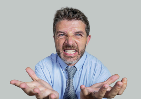 angry and furious businessman in shirt and necktie scolding and nagging fierce on company subordinate isolated on white background in business stress and job problem concept