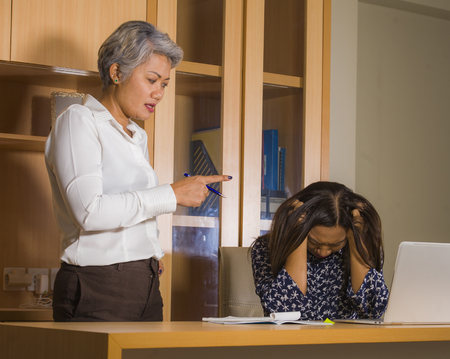 unhappy and upset Asian business woman nagging and scolding on employee girl angry for mistake made by the secretary in boss or chief authority and assistant suffering reprimand concept