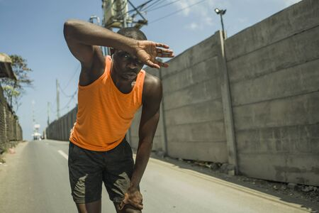sport lifestyle portrait of tired and exhausted black badass looking African American man breathing cooling off after hard running workout in fitness sacrifice and athlete training commitment 版權商用圖片