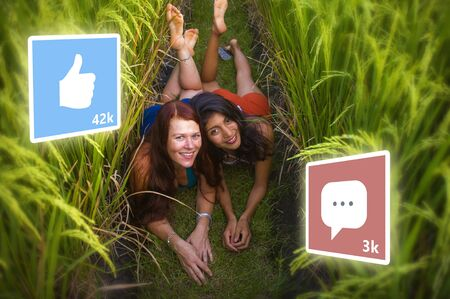 app likes and comments feed composed with young successful and happy tourist girls taking girlfriends selfie together in beautiful tropical landscape in digital nomad social media influencer concept