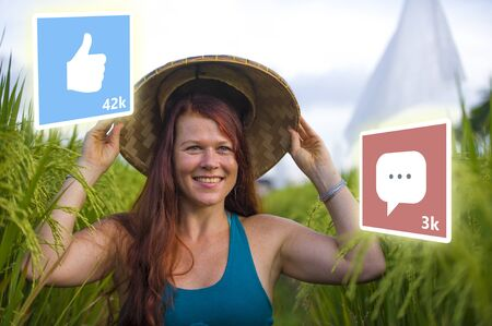 app likes and comments feed composed with young attractive and happy tourist woman taking selfie in beautiful tropical landscape as digital nomad and successful social media influencer Stock Photo