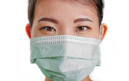 young beautiful Asian woman in protective face mask in prevention against Coronavirus epidemic outbreak.