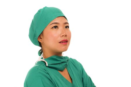 Asian Chinese woman as successful physician - young beautiful and happy medicine doctor or chief hospital nurse in green scrubs and surgeon hat smiling confident in health care concept