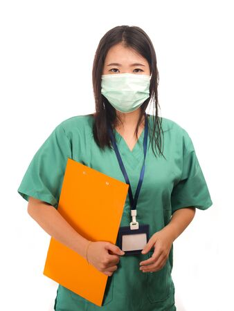 young beautiful Asian Korean medicine doctor woman or hospital nurse holding clipboard  in scrubs using protective medical face mask in prevention against virus infection isolated on white background