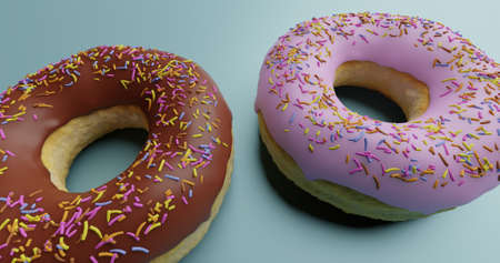 unhealthy but tempting sugary dessert - two yummy and delicious donuts with colored sprinkles one chocolate and one pink icing on blue table- calories and sugar abuse nutrition concept