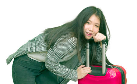 young happy and beautiful Asian Korean woman carrying tourist suitcase ready for holidays trip smiling cheerful and excited isolated on white background