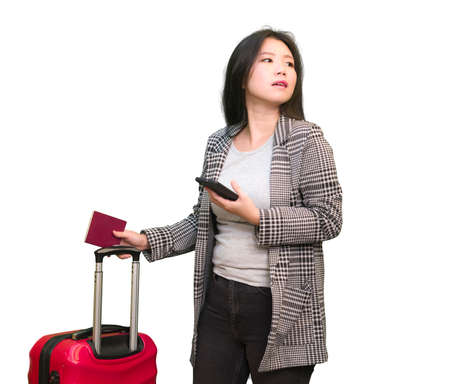 young happy and beautiful Asian Korean woman carrying suitcase holding passport and mobile phone ready for holidays trip smiling cheerful and excited isolated on white background