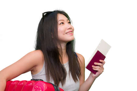young happy and beautiful Asian Chinese woman carrying suitcase holding passport and boarding pass ready for holidays trip smiling cheerful and excited isolated on white background