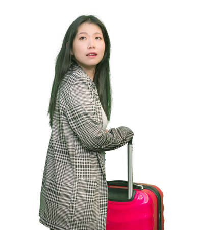 young happy and beautiful Asian Korean woman carrying tourist suitcase ready for holidays trip cheerful and excited isolated on white background