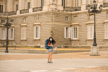 new normal backpacker in holidays travel - young happy and attractive Asian Korean woman in face mask enjoying city tour cheerful in post covid19 lockdown tourism