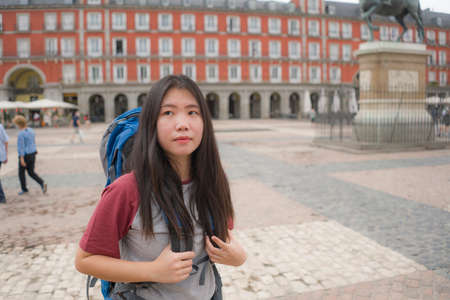 young Asian woman visiting Europe in holidays as backpacker tourist