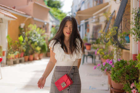 young attractive and carefree Asian Japanese woman doing city tour walk around beautiful town of Seville in Spain enjoying summer holidays travel in Europe tourism concept 版權商用圖片 - 153995805