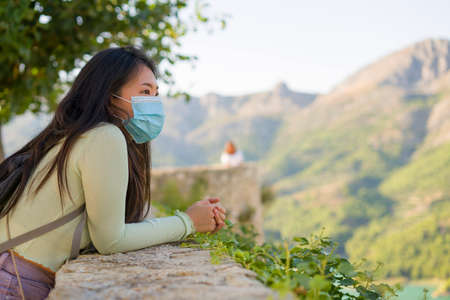 lifestyle portrait of young happy and cheerful Asian Chinese tourist woman visiting Spain during Summer holidays travel hiking and enjoying nature from beautiful viewpoint