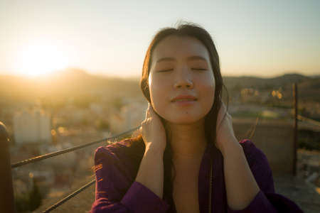 young happy and beautiful Asian Korean woman outdoors at viewpoint balcony enjoying sunset view of Spain town during Europe holiday travel feeling free and relaxed 版權商用圖片 - 154496134