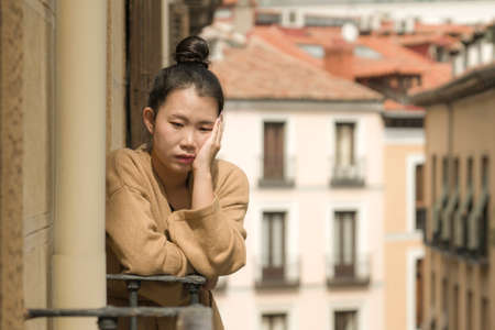 dramatic portrait of young beautiful sad and depressed Asian Japanese woman feeling unhappy and worried suffering some problem going through depression and anxiety crisis