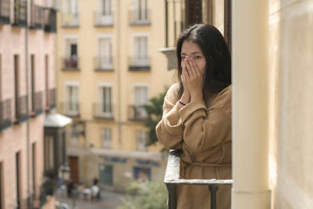 dramatic portrait of young beautiful sad and depressed Asian Chinese woman feeling unhappy and worried suffering some problem going through depression and anxiety crisis