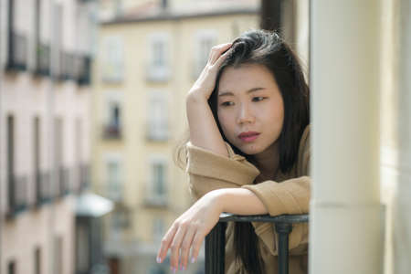 dramatic portrait of young beautiful sad and depressed Asian Korean woman feeling unhappy and worried suffering some problem going through depression and anxiety crisis
