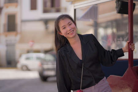 lifestyle portrait of young beautiful and happy Asian Korean woman enjoying Summer holidays in Europe walking cheerful at Spain Andalusia village in tourism and travel concept 版權商用圖片