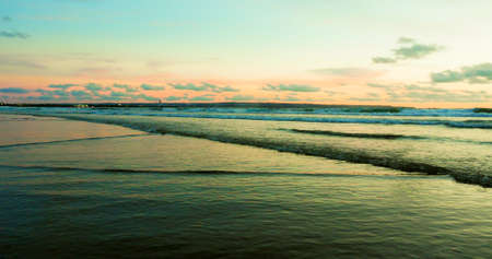 beautiful panoramic view of Asian beach - sunset orange sky over Bali island in Indonesia in travel destination and exotic Summer holidays concept