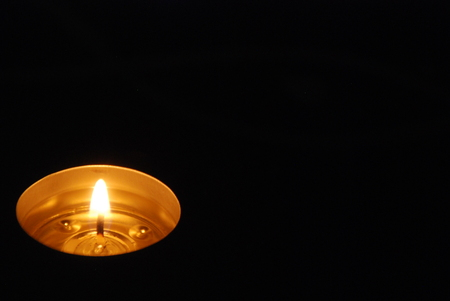 red oil lamp: Candle light glowing gracefully in the dark