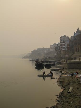 varanasi: Ganges river and the ghats of Varanasi at sunset, India Stock Photo