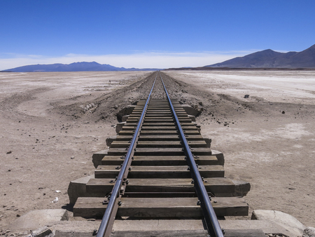 industrial wasteland: Railway crossing the desert in the south of Bolivia Stock Photo